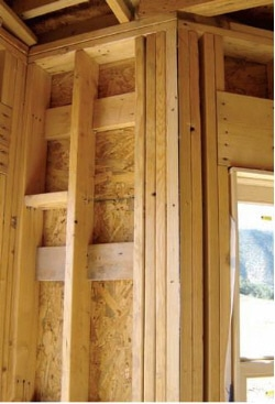 Insulated stud frame wall