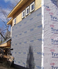 Building wrapped in Tyvek insulating material