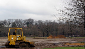Bulldozer moving dirt on site