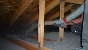 blowing cellulose insulation using a power blower