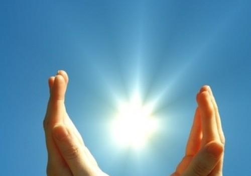 hand sun nd blue sky shutterstock_57793573