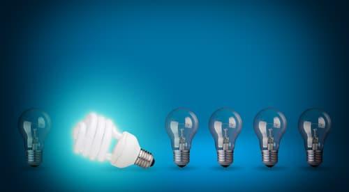 row of light bulbs and energy save bulb shutterstock_129363341