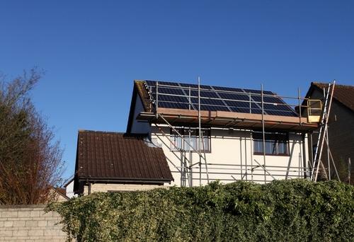 solar panels being installed shutterstock_90943538