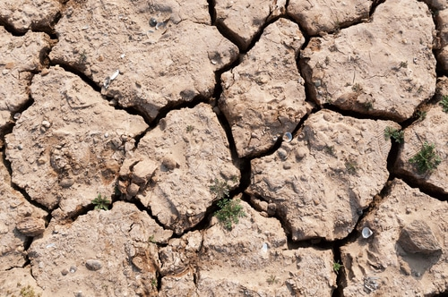 lake bed drying up from drought shutterstock_163758758
