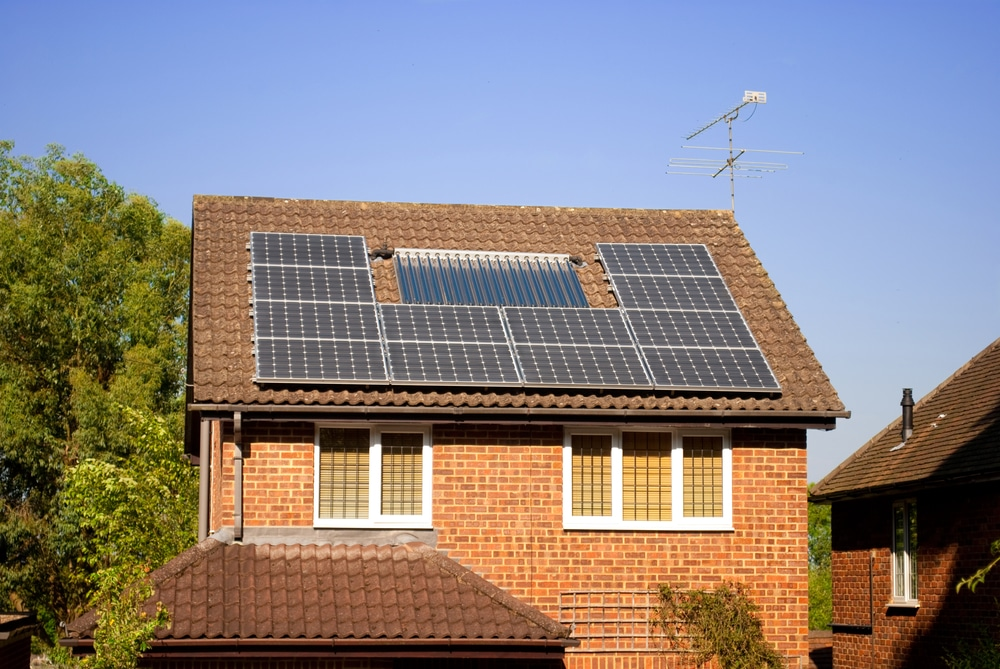 house with solar panels on roof shutterstock_82775218