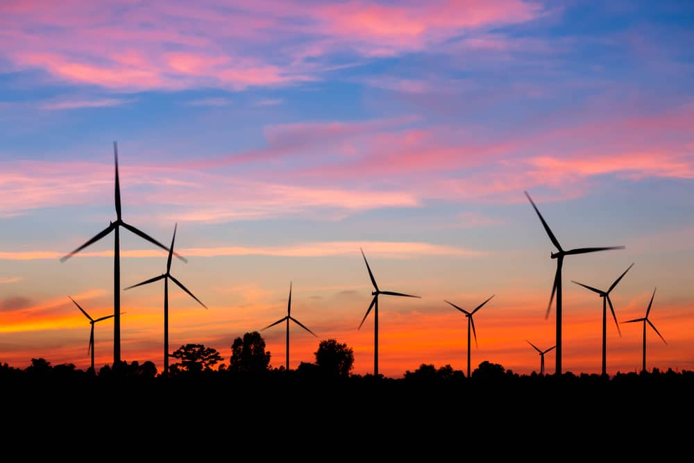 sunset wind turbines shutterstock_168941363