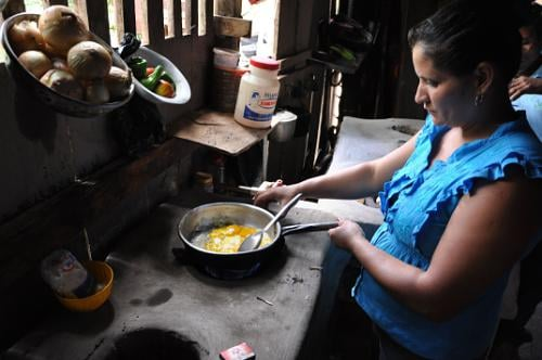 Coffee farmers cook with biogas made available through the Energy from Coffee Wastewater Program