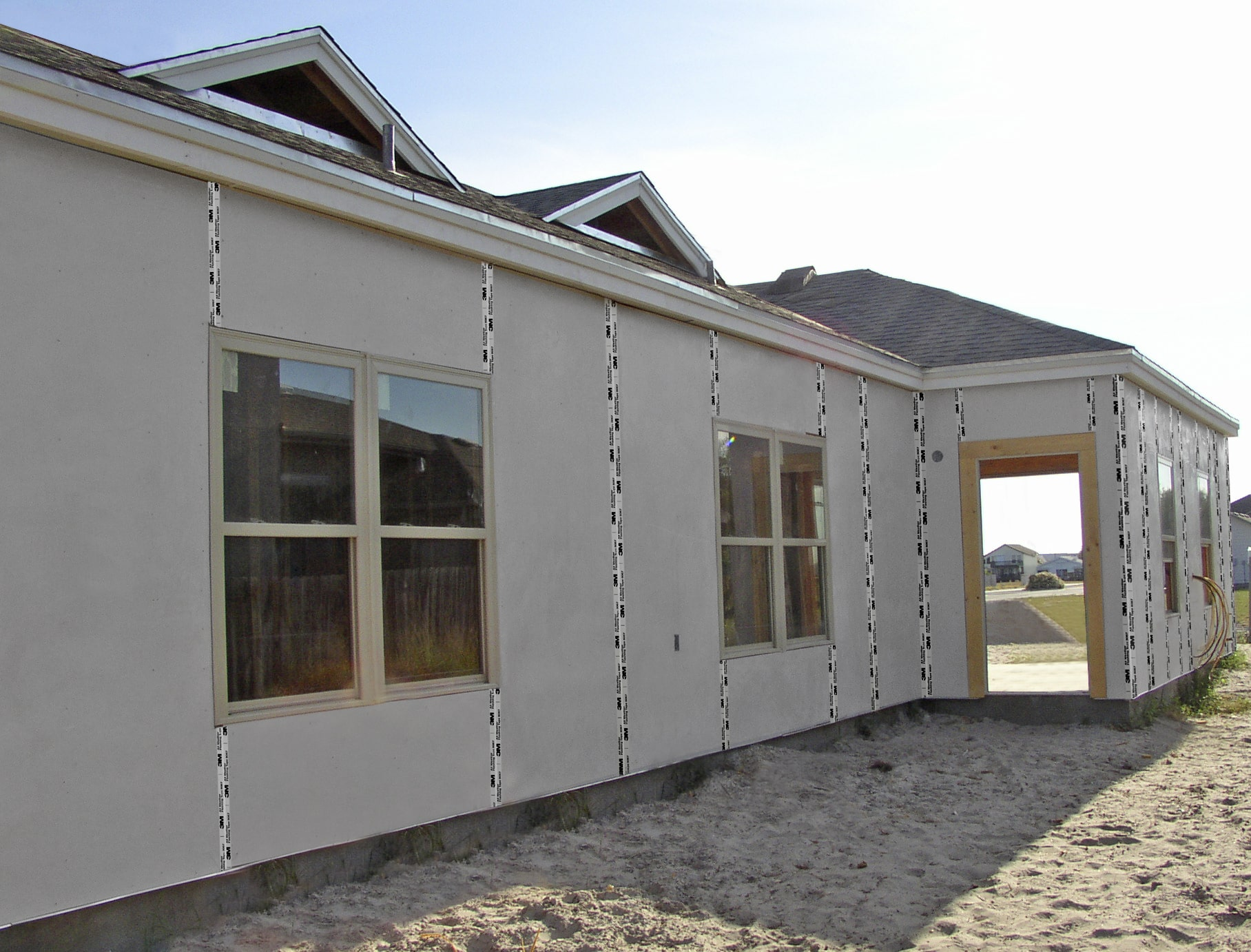 Exterior sheathing system improves energy efficiency for Exterior wall sheeting