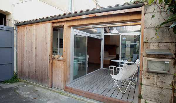 Tiny House In Garage Has French Style