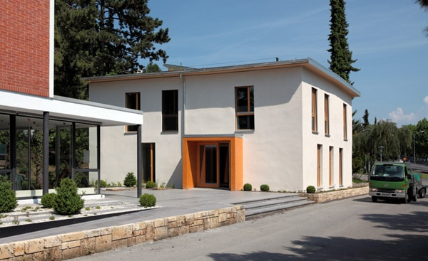 ECO-46 is a carbon neutral straw bale building in Lausanne, Switzerland