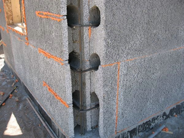 New insulated concrete blocks from recycled styrofoam for Insulated concrete form house