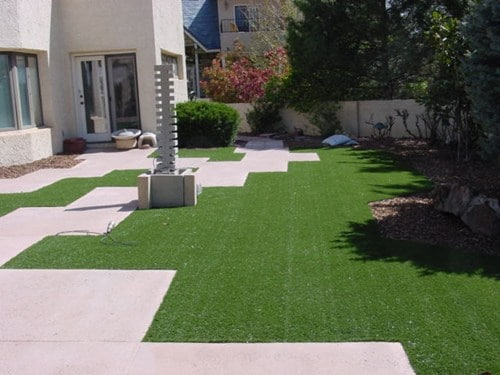 Artificial turf requires very little maintenance - Photo by WaterQuest Inc