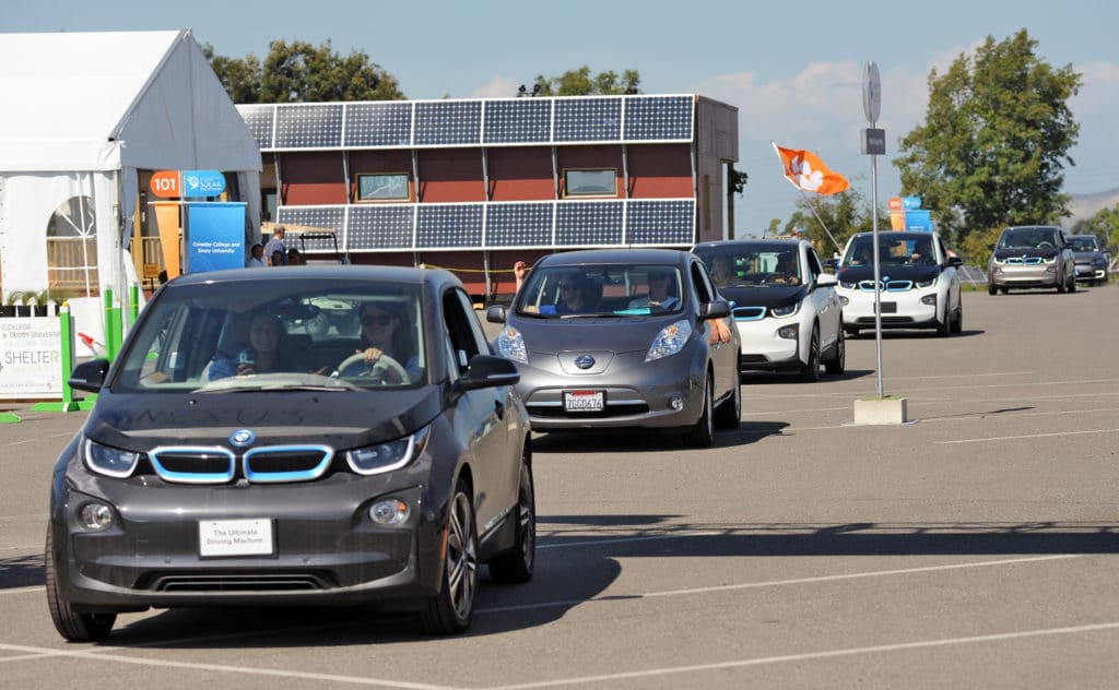 Electric cars parade down Wells Fargo Way at the U.S. Department of Energy Solar Decathlon 2015 at the Orange County Great Park, Irvine, California (Credit: Thomas Kelsey/U.S. Department of Energy Solar Decathlon)
