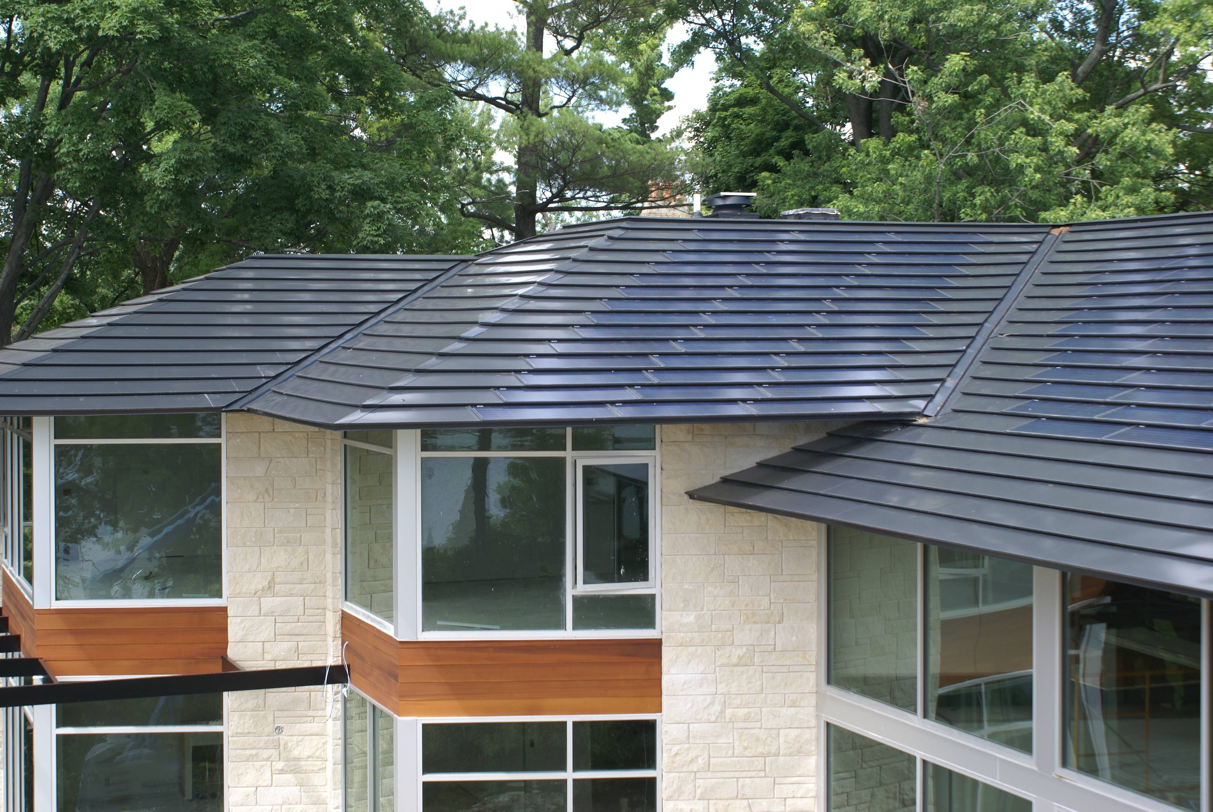 Meet The Men Who Put Solar Shingles On The Roof